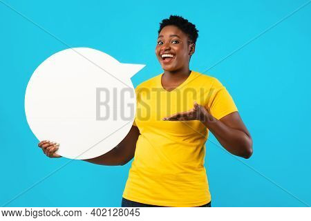 Happy Black Lady Posing With White Speech Bubble Showing Her Opinion And Thoughts Standing Over Blue