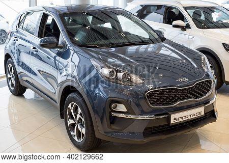 Russia, Izhevsk - December 28, 2020: Kia Showroom. New Sportage Car In Dealer Showroom. Front And Si