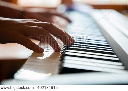 Close Up Of Woman Hands Playing The Piano, The Pianist Playing