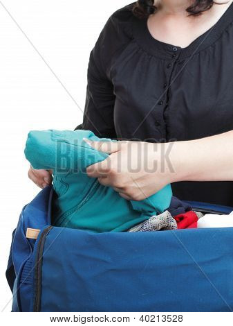 woman crammed full of clothes in black and blue shoulder bag isolated on white poster