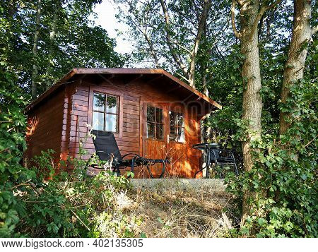 Beautiful Small Wooden House In The Forest As A Great Place For Outdoors Nature Vacation Place