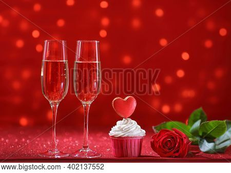 Bright Red Heart On The Muffin For Valentine's Day With Rose Flower And Two Glasses Of Champagne. Co