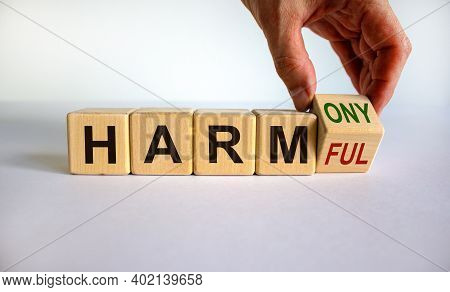 From Harmful To Harmony. Male Hand Turns The Cube And Changes The Word 'harmful' To 'harmony'. Beaut