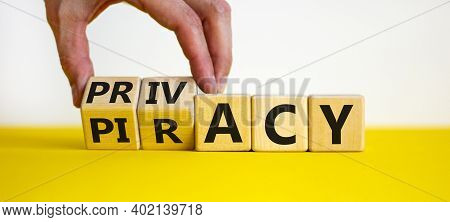 Privacy Vs Piracy Symbol. Businessman Hand Turns Cubes And Changes The Word 'piracy' To 'privacy'. B