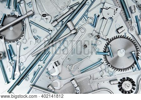 Metal Tools. Metal Style. Many Metal Tools On The Scratched Metal Background.