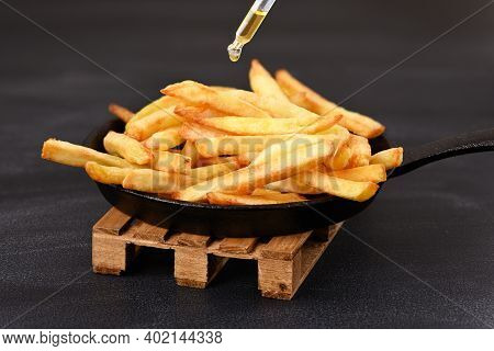 Fried Fries In A Frying Pan With A Drop Of Oil. Prepare French Fries Healthily.