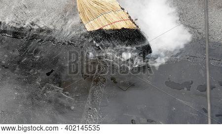 Roof Repair, Fill Cracks With Tar. A Quick Roof Repair. Improper Roof Repair. Tar Poured Broom.