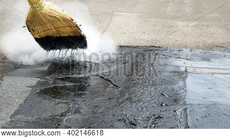 Roof Repair, Fill Cracks With Tar With A Broom. Fill Cracks In The Roof Tar, A Partial Roof Repair