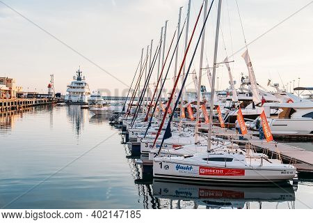 Sochi, Russia - June 5, 2018: Sailing Yachts And Private Boats Moored At Pier In Sochi Seaport  At S