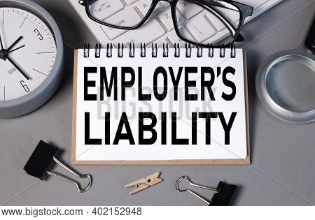 Employer's Liability. Text In Notepad On Gray Background. Business Concept