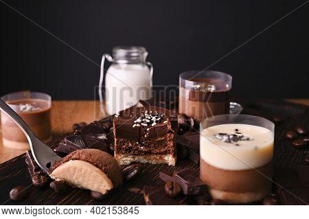 Dessert Cut. Dessert Cutpanna Cotta With Chocolate. Traditional Italian Dessert, A Person Tastes A P