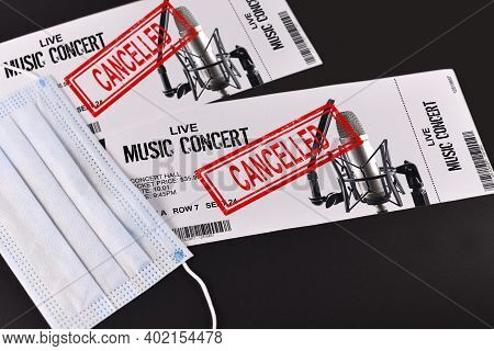 Concept For Cancelled Entertainment Events During Corona Virus Pandemic With Concert Tickets And Red