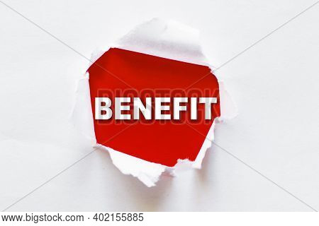 White Torn Paper With A Word Benefit. Business And Benefits Concept.