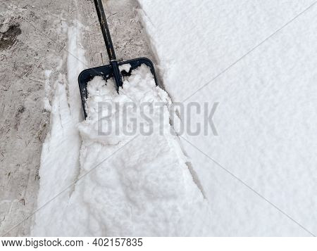 Somebody Is Shovelling Snow With A Plastic Shovel Full Of Snow, Snow Removal Tool, Shoveler Cleaning
