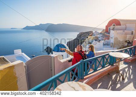 Santorini, Greece - September 17, 2020: Tourists Visit Oia Village On Santorini Island, Cyclades, Gr