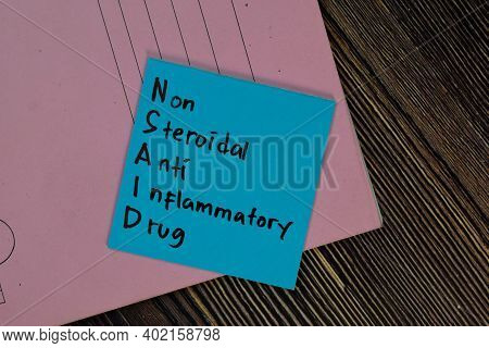 Nsaid - Non Steroidal Anti Inflammatory Drug Write On Sticky Notes Isolated On Wooden Table.