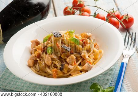 spaghetti with fresh salmon tomatoes and eggplant