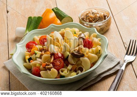 cold salad pasta with eggs capsicum mushroom and courgette