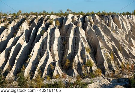 The Slope Of A Limestone White Mountain With Large Cracks And Rough Texture From Natural Erosion. Th
