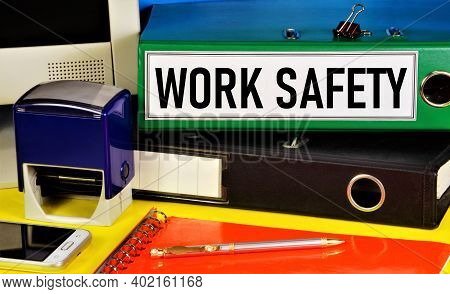 Work Safety. Text Label On The Folder. Monitoring The State Of Working Conditions To Reduce Injuries