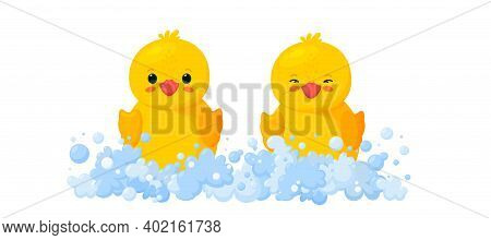 Rubber Ducks In Soap Foam With Bubbles Isolated In White Background. Front View Of Yellow Plastic Du
