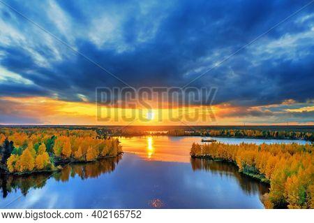 Colorful Autumn Landscape. Colorful Autumn Landscape. Forest Lake With Autumn Forest. Dramatic Sunse