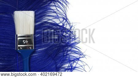 Classic paint brush with white bristles and blue handle