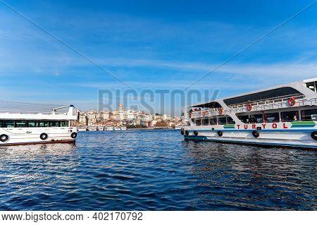 Istanbul, Turkey - 9 December 2020: Motor Boats Sailing Along Bay Golden Horn
