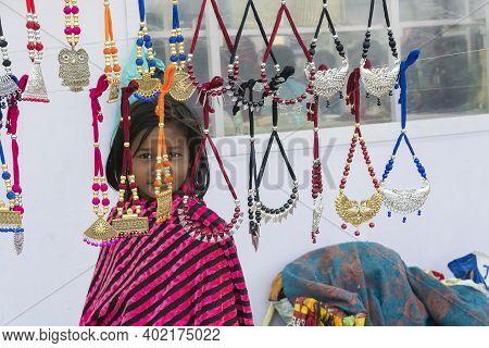 Kolkata, West Bengal, India - 31st December 2018 : A Girl Looking At Various Shapes And Shades Of Ne