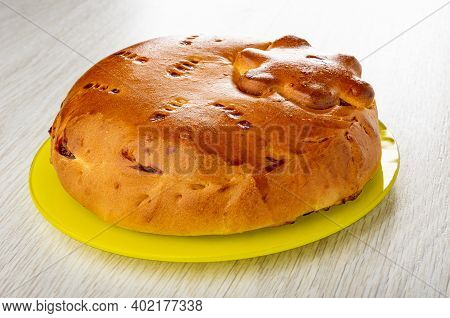 Homemade Savory Pie With Filling In Yellow Glass Plate On Wooden Table