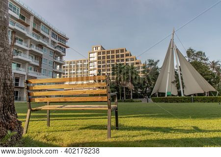 Bangkok, Thailand - Jan 06, 2021 : Wooden Benches On Grass Floor In A Shady Area Of The Park At Cond