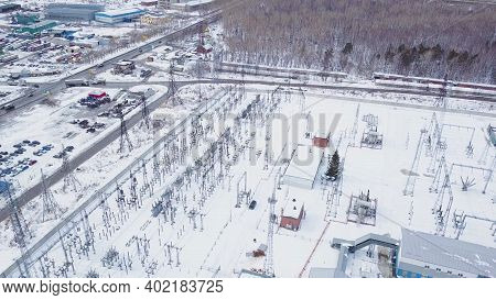 Top View Of Electric Substation. Action. Power Plant With Rows Of Transformers Located In Suburbs. E
