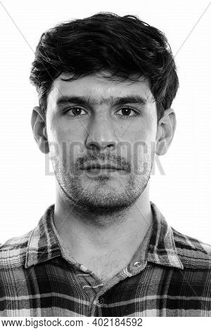 Studio Shot Of Face Of Young Persian Man
