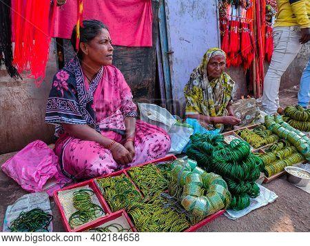 Tulajapur , Maharashtra, India- December 16th 2019; Two Old Women Sitting On Indian Street Market An