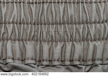 Close up shot of stretchable wrinkled fabric with stitches