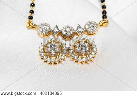 Close up shot of traditional Indian necklace with real diamonds