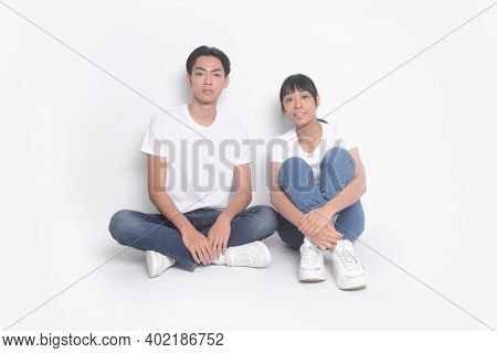 Loving couple sitting on on a white background. Relationship concept.