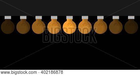 Set Of Nine Incandescent Light Bulbs Hanging On Black Background