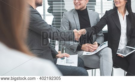 Handshake Of Colleagues Before The Business Seminar.