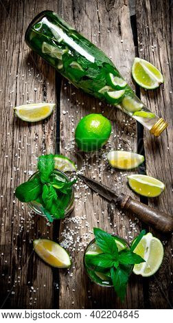 Mojito Cocktail . The Ingredients For The Cocktail - Limes, Mint, Knife, Is Also Prepared Cocktail I