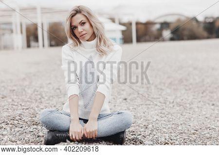 Young Beautiful Blonde Caucasian Woman Walks Alone Enjoying The Spring Weather. Beautiful Girl, Outd