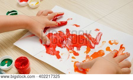 Closeup Of Colorful Drawing Picture Drawn With Child Fingers. Little Boy Painting With Colorful Goua