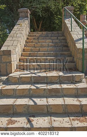 Closeup Detail Of Stone Paved Steps On Rural Footpath Walkway Going Upwards In Formal Garden Grounds