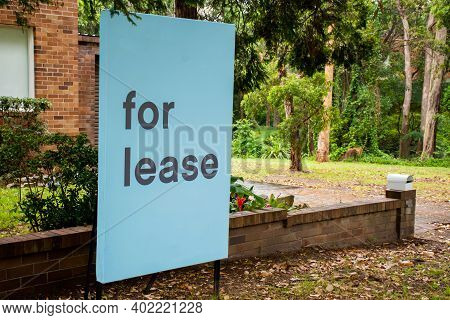 For Lease Sign On A Blue Display Outside Of A Resedential Building In Australia