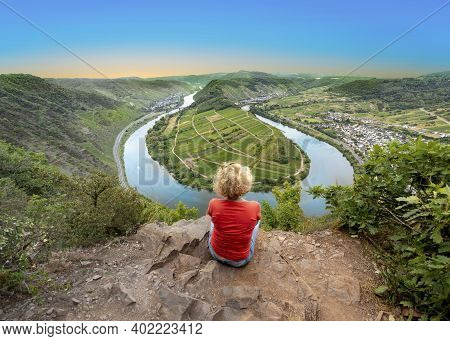 Woman Looking At  Scenic Moselle River Loop At Village Of Bremm