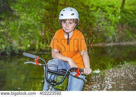 Young Boy Has Fun Resting At His Bmx Bike