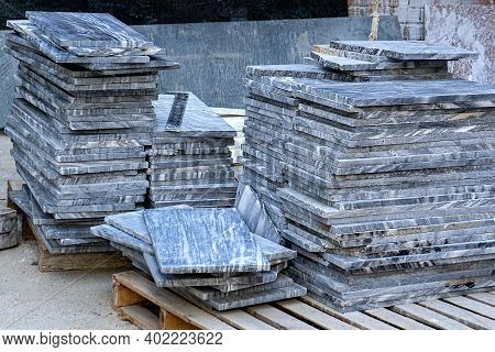 Stack Of Granite Slab At Construction Site. Decoration Of Walls And Floors In The Building With Natu