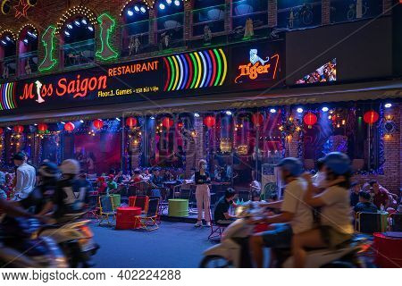 Walking Street Bui Vien During Lockdown. People Are Relaxing On The Open Terrace In The Night Restau