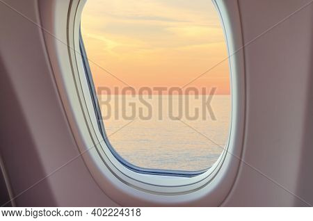 View From Airplane Window To The Blurred Sea Horison At Sunset