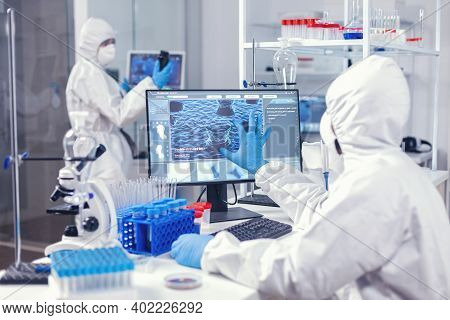 Biochemistry In Medicine Working In Modern Facility To Find A Cure For Coronavirus Dressed In Covera